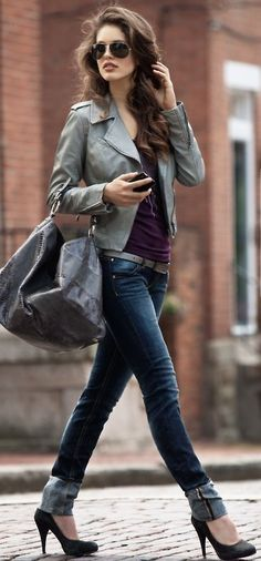 Beautiful grey-green leather jacket, plum top, dark wash jeans, black pumps, large handbag, aviators