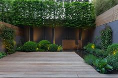 A steel water feature is part of a small pond that wraps around two sides of the patio and adds to the overall feelings of relaxation experienced when spending time in the space.