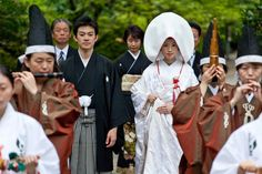 This is a Shinto style wedding ceremony. Seven people who serve Shinto Gods attend and host this ceremony.