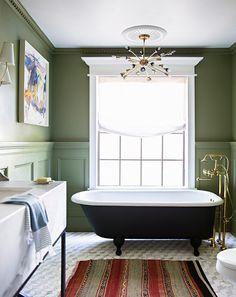 green bathroom walls + clawfoot tub