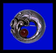 Georg Jensen. Design no. 10. Sterling silver and carnelian fish brooch.