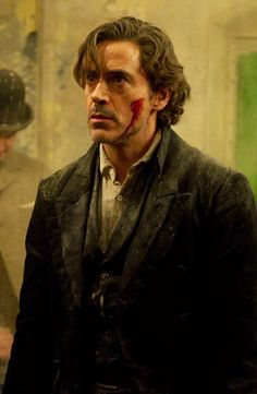 "Robert Downey Jr. as Holmes in ""Sherlock Holmes: A Game of Shadows"""