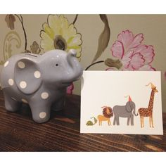 This animal parade card by @riflepaperco makes us smile!  We also love this little elephant bank by @elegantbabyofficial!  #Cardoftheday