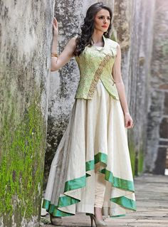 Look extraordinary and fashionable by cladding into this fascinating cream color evening wear designer gown. This designer party wear gown is made from silk fabric and it is embellished with captivating hand work that gives a brilliant look to the outfit. Party Wear Indian Dresses, Indian Gowns Dresses, Pakistani Dresses, Party Wear Kurtis, Indian Designer Outfits, Designer Dresses, Kurta Neck Design, Anarkali Dress, Anarkali Suits