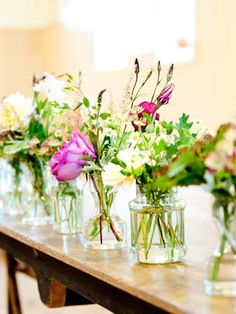 Jam jars filled with flowers for reception