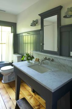 "Restored Farmhouse Bathroom I love this ""new"" bathroom in an old house. The smallish sink with the large marble surround and backsplash looks perfect. The old wide-board floors were saved and will enjoy a new life in this wonderful bath. Wish we could see the rest of the room. 