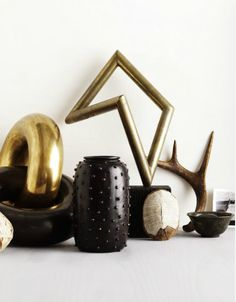 I want a shelf with these things on it...warm/cool black/gold absolute perfection