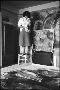 Helen Frankenthaler contemplates an Abstract Expressionist painting in her studio, 1957