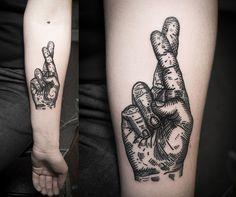 Crossed fingers tattoo