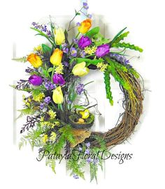 A personal favorite from my Etsy shop https://www.etsy.com/listing/590012361/purple-yellow-spring-tulip-wreath-spring