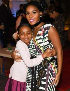 Hidden Figures costars Saniyya Sidney and Janelle Monáe embrace at the African American Film Critics... - Getty Images
