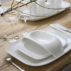 It saves room on the table with the salad plate raised and it just looks cool. I like the simplicity