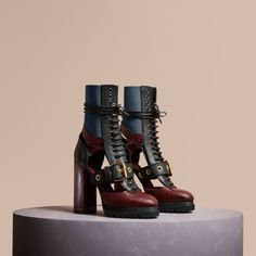 Italian-crafted brogue detail boots in cut-out leather and snakeskin set on a high block heel. A corset-inspired lace-up closure is framed by contrast-colour stretch side panels for an adaptable fit.