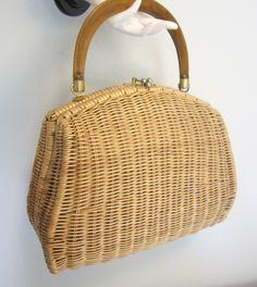 50-60's Jackie O Large Wicker Kelly Handbag Purse. $48.00, via Etsy.