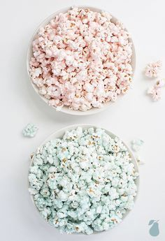 Fun gender reveal party ideas include pink and blue snacks like coated popcorn.
