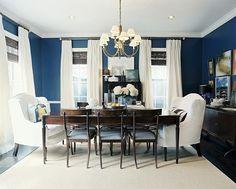 classic navy dining room & love the big chairs.  Roman shades with tall panels.  I would add lime green accents, or greenery.