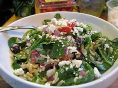 spinach orzo greek salad - passing on the onions and tomatoes and adding capers. :)