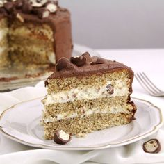A festive hazelnut cake with a decadent mascarpone-condensed milk filling and a chocolate-Schoko Bons topping.