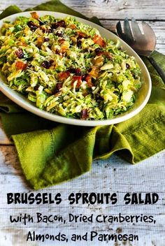 Brussels Sprouts Salad with Bacon, Dried Cranberries, Almonds, and Parmesan; this amazing salad can mostly be made ahead and tossed together when it's time to eat. Just omit dried cranberries for a low-carb salad if you wish. [from KalynsKitchen.com] #BrusselsSproutsSalad