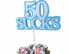 Items similar to Birthday Lollipop Bouquet or Cake Topper - 50 Sucks, Blue and Silver or Your Colors on Etsy 50th Birthday Decorations, 50th Birthday Party Decorations, Birthday Parties, Birthday Ideas, Lollipop Bouquet, Candy Bouquet, Sucker Bouquet, Happy 50th Birthday, How To Make Notes
