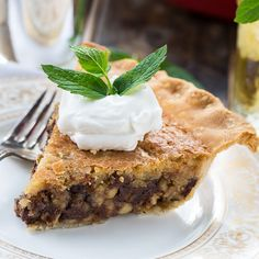 Kentucky Derby Pie has a gooey chocolate and walnut filling with a splash of bourbon. Top with bourbon whipped cream! @FMSCLiving