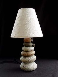 """Maine Cairn Rock Lamp - 160.USD - """"Named for the cairn rock trail markers used on our Maine hiking trails. Carefully selected beachstones are stacked, scribed and ground so they fit together perfectly. Lamps are bolted-thru for a very secure and handsome lamp. We create a handmade paper shade that is included and really complements each lamp. Lamp height approx. 15"""" to top rim of shade."""" From Mark Guido, Timberstone Rustic Arts (Mainerockguy on etsy)"""