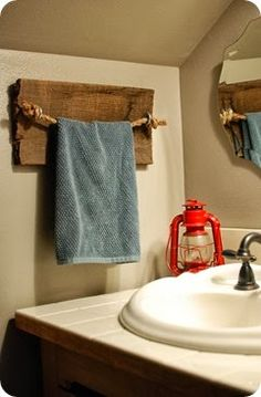 a rustic DIY rope and barn wood towel holder for the bathroom / powder room on will work for decor blog