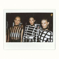 Aymeline Valade (Viva), Issa Lish (Premium) and Ondria Hardin (Elite) backstage at Balmain SS15
