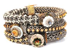 love the mixed metal beads and use of embellishment - reminds me of Marcia DeCoster's beaded bangles