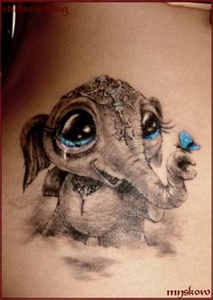 cute smiling elephant tattoo blue eyes and butterfly