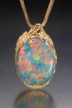 a real fire opal can cost thousands! Beautiful - no imitation can match it.