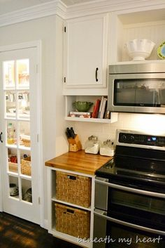 if redoing an older kitchen, move cabinets up to ceiling height, then add under-cabinet storage for cookbooks/spices/etc.  I also love the baskets and butcher-block.  thanks Beneath My Heart