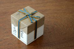 A wooden box or tomobako that accompanies a ceramic lid-rest by Okada Yu.