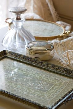 Through Beverly Ruff's creativity, lace-topped vanity trays have become beverage-serving salvers and wall hangings.