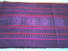 We love these Thai ethnic fabrics. This would look great as a table runner or home decor accessory.