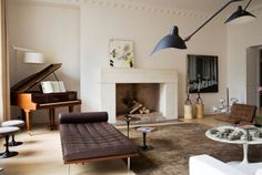 The coolest apartments are always in Paris. This one is by Monaco interior architect team Humbert & Poyet. A stunningly simple fireplace, graphic artwork, classic furnishings by the likes of Eero Saar Home Interior, Interior Architecture, Interior Decorating, Luxury Interior, Decorating Ideas, Decoration Inspiration, Interior Inspiration, Decor Ideas, Chimenea Simple