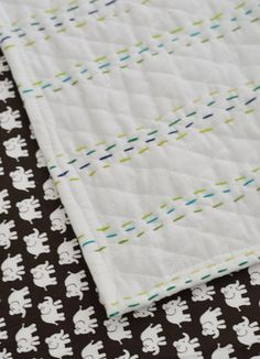 Totally making one of these bad boys for Alice in girly colors!! So cute and easy.  A Quilt For The Bun   Young House Love