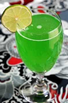 Green Demon cocktail with Midori, vodka, rum and lemonade. Get this drink recipe at http://mixthatdrink.com/green-demon/