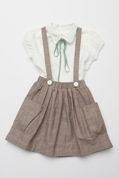 Add suspenders to the Oliver + S Hopscotch Skirt for a similar look?