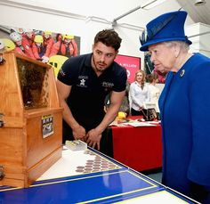 The Queen meets the queen bee Her Majesty was shown a swarm of 30,000 bees by Prince'...