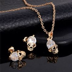 "Skull Earring and Necklace Set Adorable new skull earring and necklace set. Gold alloy. Chain is 18"" Jewelry Necklaces"