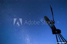 Silhouetted Windmil against a starry blue night sky with the Milky Way. - Buy this stock photo and explore similar images at Adobe Stock Milky Way, Windmill, Night Skies, Stock Footage, Adobe, Southern, Silhouette, Sky, Stock Photos