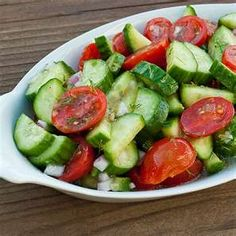 Been eating this simple salad since I was a kid.  Here's how I make it...  - seedless cucumber with peel sliced then cut in half or quarters.  - cherry tomatoes cut in half  - Feta  - Garlic Expressions Dressing