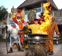 Chef Jason Jakubowski demonstrates some onstage cooking while preparing the seared lamb chops with tamarind pomegranate sauce, during a Harambe Nights cast preview at Disney's Animal Kingdom!
