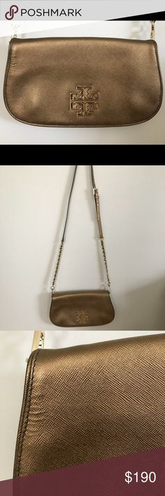 Gold Tory Burch Crossbody This purse has been used only a few times and is in great condition! Any flaws can be seen in the above photos. It is 11.5 inches wide and 6.5 in height. I was able to fit my iPhone 7 Plus, a small coin purse, and some chapstick and a few other very small things in it. For questions, please feel free to comment! Tory Burch Bags Crossbody Bags