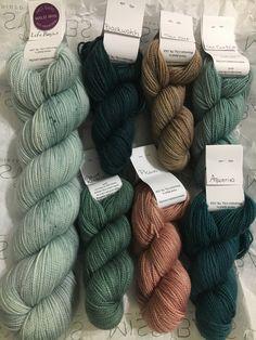 "Shades of blue-green yarn with ""Sea Oat"" and ""Picuri"" for knitting the #BaysEdge shawl pattern.  #missbabsyarn #shawlpattern #rectangleshawl #yummytwoply"