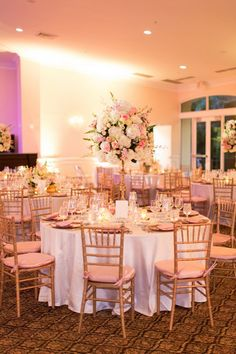 Gorgeous tables decorated with shimmering linens, pink napkins and gold charger plates, surrounded by chiavari chairs. {Thompson Photography Group}