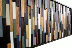 Reclaimed Sea Crest Modern Wood Wall Sculpture in Browns, Blues, Green, and White. This wood wall sculpture reminds me of the sea. The rich browns, blues, and greens combined with the choppy texture o