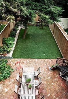 Backyard with bulb lights stringed above. a small patio set, and grass small backyard design Backyard Patio Designs, Small Backyard Landscaping, Landscaping Ideas, Backyard Pavers, Backyard Privacy, Simple Backyard Ideas, Narrow Backyard Ideas, Backyard Layout, Backyard Trees