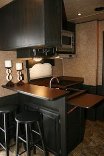 This is a little dark for me, but I do like the fold-down counter extension and the bar with stools.